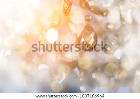Crystal chandelier close-up. Glamour background with copy space - Shutterstock ID 1007106964
