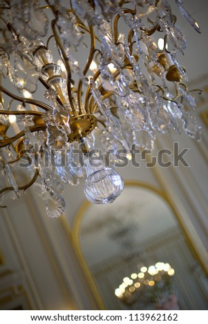 Crystal chandelier in the living room of a mansion in France