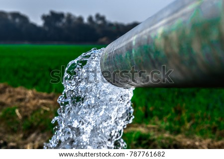 crystal clear sweet and healthy water being flush out by a heavy diesel engine tube well  in the wheat fields where the river water can't reach