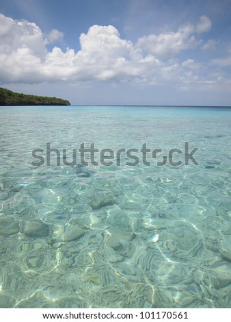 Crystal clear, turquoise waters and white sandy beach of caribbean sea in Curacao