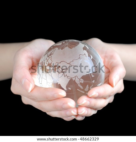 Crystal Earth In Hands isolated on black ground - stock photo