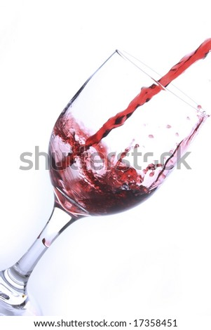 Crystal glass with splash of red wine
