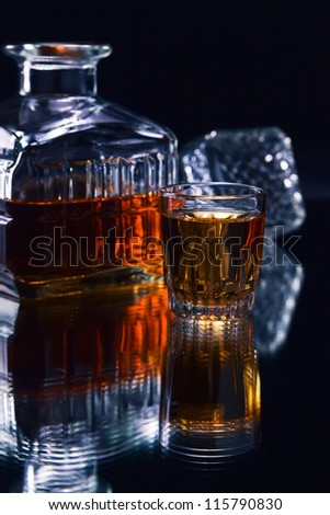 crystal glass with whiskey on a dark background
