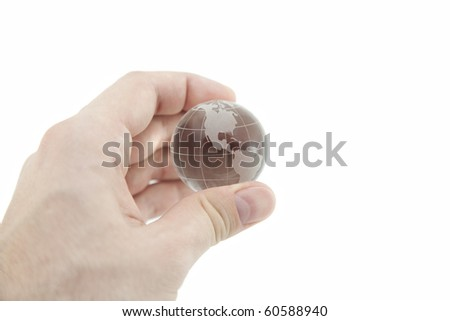 Crystal globe in hand with clipping path