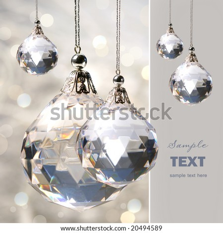 Crystal ornament hanging against shimmering background