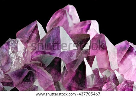 Crystal Stone macro mineral, purple rough amethyst quartz crystals on black background #437705467