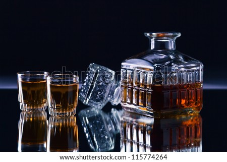 crystal whiskey decanter on a dark background