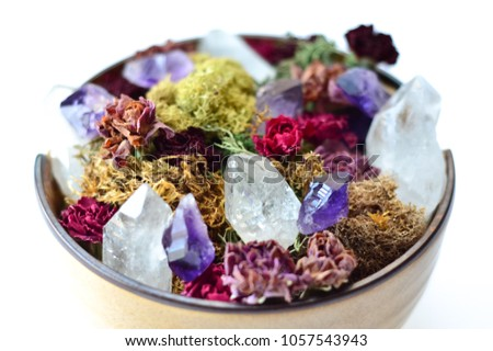 crystals and moss with dried flowers in bowl with crystals on white background #1057543943