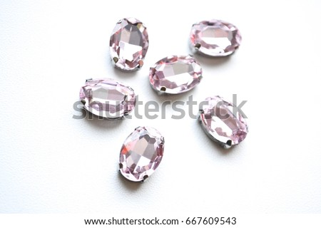 Crystals. Crystal strasses on a white background. Beautiful shiny sparkling pink rhinestones isolated diamond fashion gems jewelery precious strass. Jewelry, rhinestones, shiny stones.