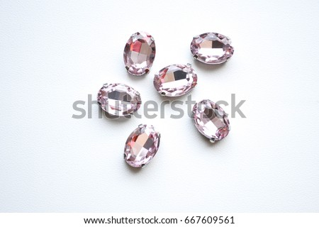 Crystals. Crystal strasses on a white background. Beautiful shiny sparkling pink rhinestones isolated diamond fashion gems jewelery precious strass. Jewelry, rhinestones, shiny stones. Cristal glass.