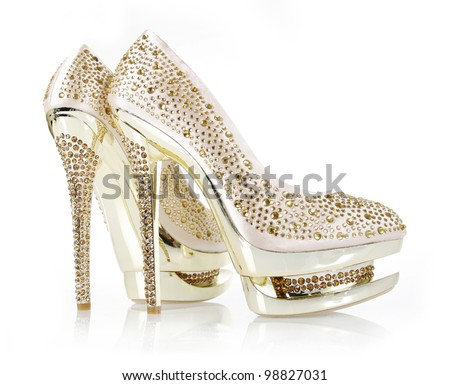 crystals encrusted gold pair of shoes isolated on white - stock photo