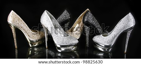 crystals encrusted shoes collection on black background