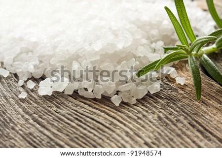 Crystals of sea salt on wooden background