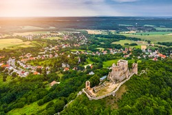 Csesznek, Hungary - Aerial panoramic view of the hilltop Castle of Csesznek and Csesznek city at sunset on a sunny summer afternoon