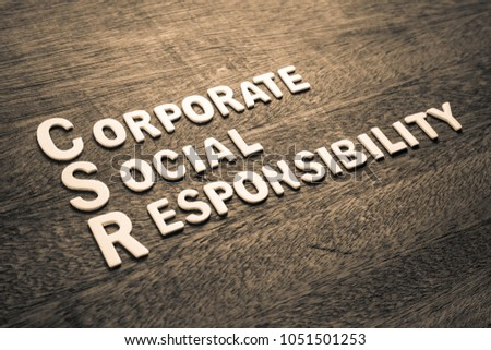 CSR abbreviation with text Corporate Social Responsibility by wood letters on wood background #1051501253