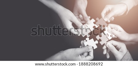 CSR (coporate social responsibility) or teamwork concept.Hands holding jigsaw.Autism awareness day kid child.business people putting jigsaw for team together.Charity, volunteer. Unity, team business.