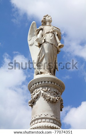 Cuba - angel statue with a trumpet in the main cemetery of Havana. Necropolis Cristobal Colon.