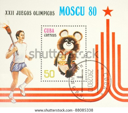 CUBA - CIRCA 1980: A post stamp printed in CUBA shows olympic bear, symbol of the Moscow Olympic games and athletics runner with olympic fire torch , circa 1980.