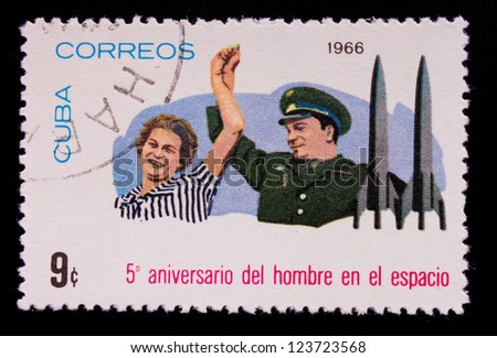 CUBA - CIRCA 1966: A stamp printed in Cuba shows a man and a woman hand in hand, circa 1966.