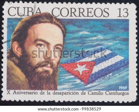 CUBA -CIRCA 1969: A stamp printed in the Cuba shows portrait Camilo Cienfuegos, 10 years of the Cuban revolution, circa 1969
