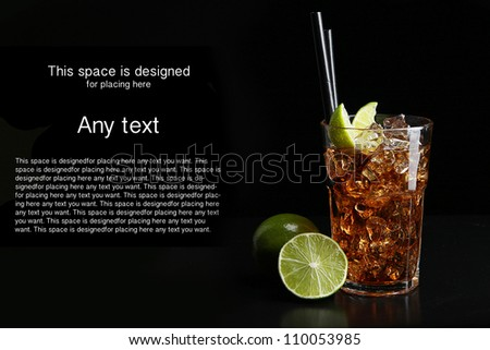 Cuba Libre cocktail, black background, ice and lime