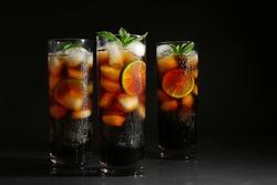 Cuba libre cocktails on dark background