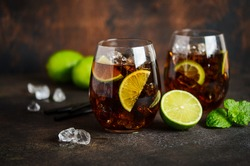 Cuba Libre with brown rum, cola and lime. Cuba Libre or long island cocktail.