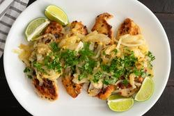 Cuban Chicken with Onions (Pollo a la Plancha): A Latin American-Caribbean dish of grilled chicken and onions (Pechuga a la Plancha)