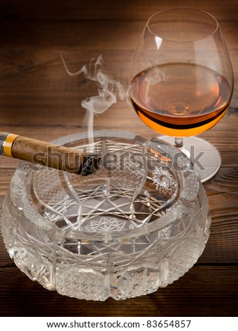 Cuban cigar and liquor drink on wood background