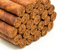 Cuban Cigars: Luxury hand made Cuban cigars on a white background. Bundles of 25 sticks. Symbol of wealth and expensive habits.