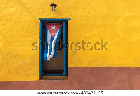 Shutterstock Cuban flag hanging on a door in Trinidad, Cuba