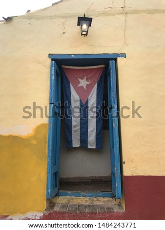 cuban flag. It's old. Colors are faded.