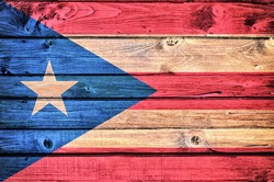 Cuban flag on the old wooden background