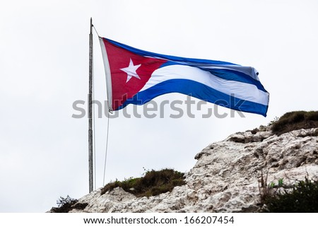 Cuban national flag on a stone hill