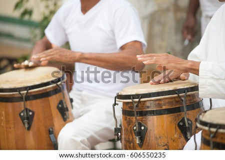 Shutterstock Cuban Performers Playing Bongo Drums at Afro-Cuban Museum in Havana, Cuba