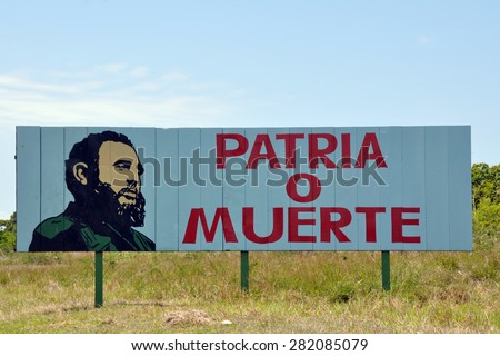 Shutterstock Cuban road advertising board stating patriotism or death