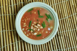 Cuban White Bean Soup melds the flavors of navy beans, pork, onions, garlic, and seasonings.