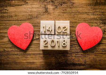 cube calendar for 14 february 2017 on wooden background with empty copy space for inscription or other objects. Wooden calendar show of February 14. wooden heart