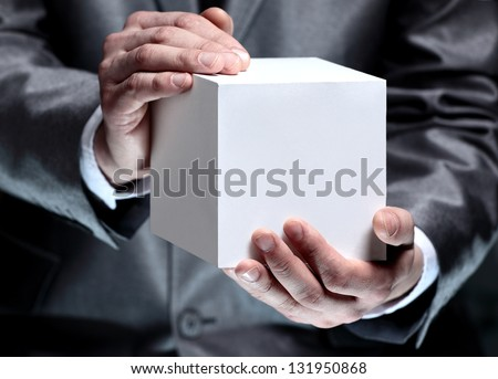 Cube in the male hands