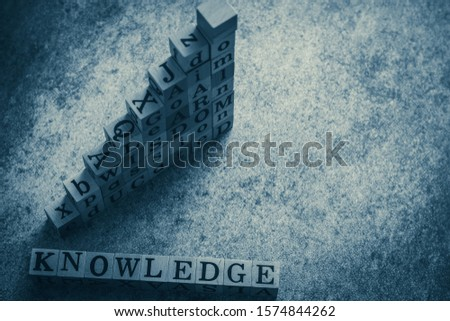 Cube letter of wording of knowledge, educated, passion, wisdom, learn, goal, aim, and do with copy space. Photo concept of business, idea and creativity, education, self learning and training.