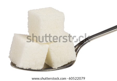 cube of white sugar on spoon ,isolated on white with clipping path.