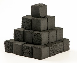 Cube shaped coal briquettes made from coconuts. Isolated on white background. Stack of coal briquettes.