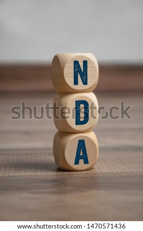 Cubes and and dice with NDA non-disclosure agreement #1470571436