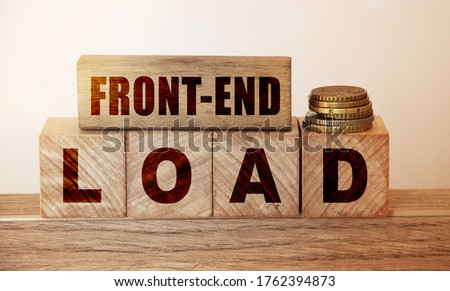 Cubes and dice with Front end load on wooden backround. Debt load financial concept. Stock photo ©