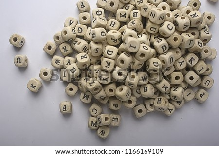 cubes beads letters alphabet / background of wooden cubes with alphabet letters, concept education reading, learning letters #1166169109