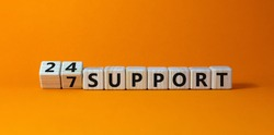 Cubes form the expression '24 7 support'. Beautiful orange background. Business concept. Copy space.