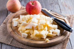 Cubes of apple on a cutting board