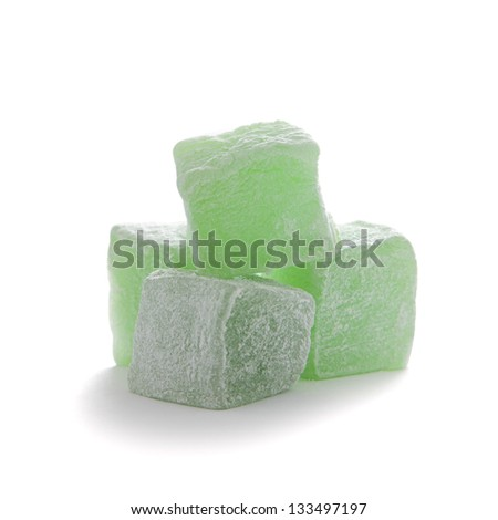 Cubes of green lokum isolated over white