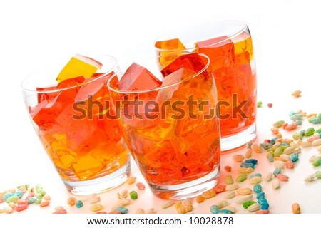 Cubes of strawberry and orange jello in glasses