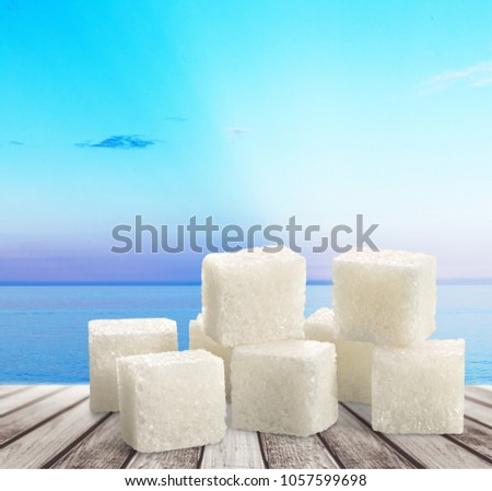 Cubes of sugar on desk #1057599698